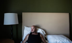 Cid Isbell on his bed at a hotel room 13 days after his surgery.