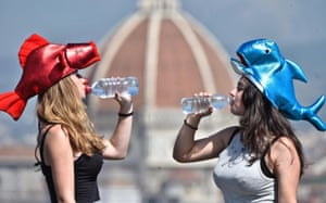 Florence, ItalyTwo girls drink water outside Brunelleschi's dome of Florence cathedral during a heat wave where temperatures are expected to reach 35-40 degrees Celsius. We aren't sure why they are wearing fish hats!