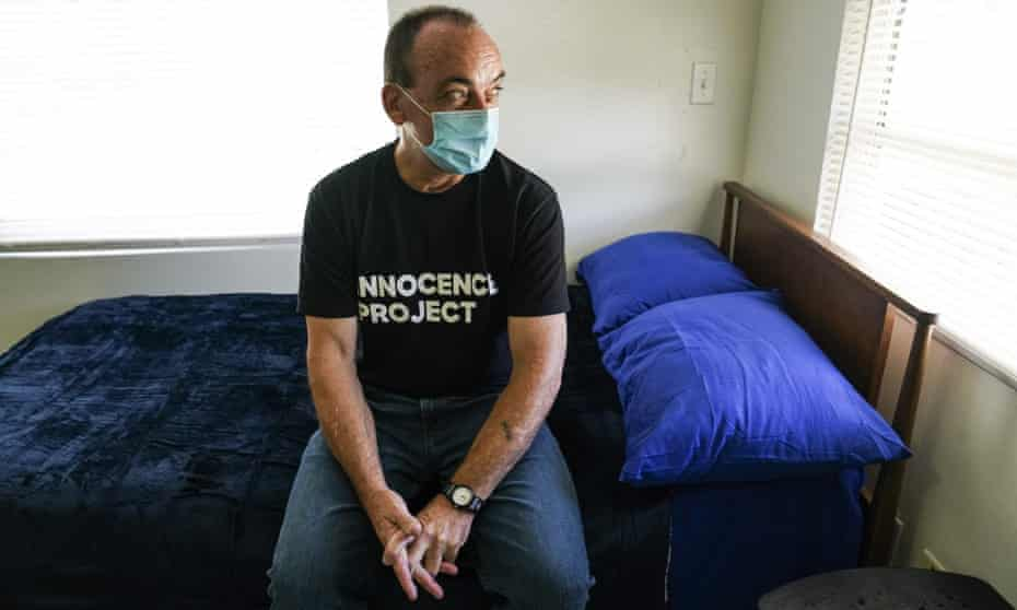 Robert DuBoise is pictured on his bed at his new home in Tampa.
