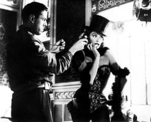 Cinematographer Raoul Coutard with Anouk Aimee on the set of Lola, 1960