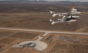Virgin Galactic vehicles WhiteKnightTwo and SpaceshipTwo fly over Spaceport America in 2010.