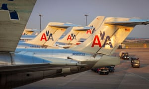American Airlines said a woman had voiced suspicion over an economics professor on a flight.