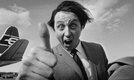 Ken Dodd arriving at London airport in 1965