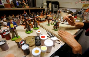 A worker paints a santon, the typical figurines from Provence, at the Marcel Carbonel's Santon factory