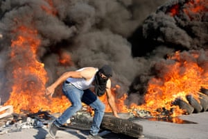 Beita, West Bank: Palestinian demonstrators clash with Israeli soldiers as they demand that the army hands over the body of man who was shot dead by Israeli forces