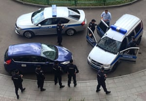 Prominent opposition figure Alexei Navalny outside his apartment in Moscow, being detained by Russian police officers on his way to a political protest