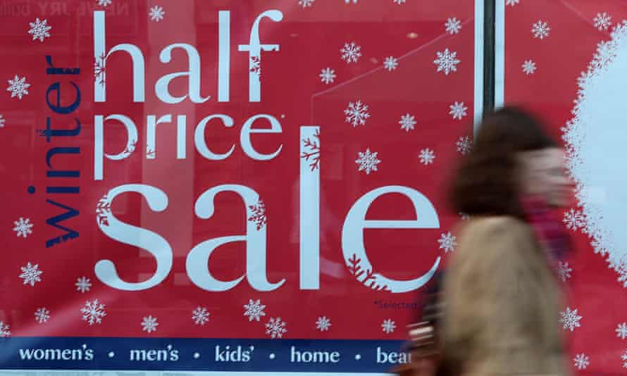 Christmas shopping  sale sign in the window of Debenhams