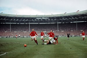 West Germany's Lothar Emmerich is crowded out by England's Moore, Stiles and Jack Charlton during the World Cup final