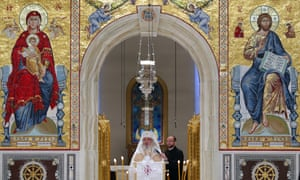 Romanian patriarch Daniel leads the service inside the cathedral