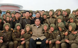 North Korea Leader Kim Jong-un poses with members of the air and anti-aircraft force of the Korean People's Army during training at an undisclosed location