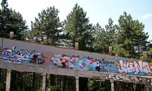 Downhill bikers tackle the bobsleigh track in 2015.