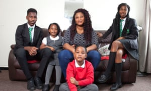 Joyce Tetteh, with her four children, had a bill of £465 for uniforms.