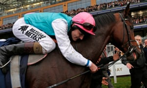 Tom Quealy hugs horse Frankel after winning The Champion Stakes.