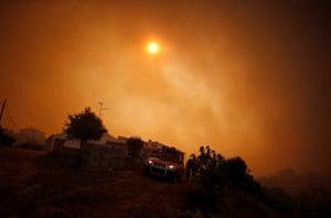 A fire truck is seen near a house in Pedreira