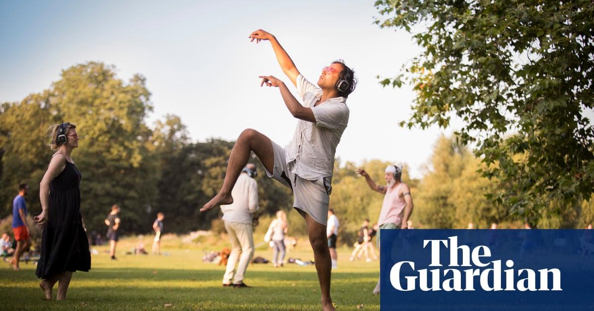Rhik Samadder tries … silent disco meditation: 'A man in socks and a bandana is romancing a tree'