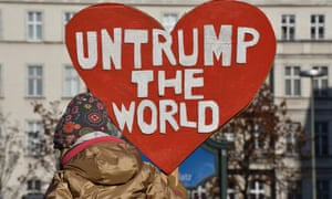 A demonstrator protesting against US president-elect Donald Trump in Berlin.