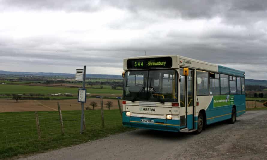 A bus travelling to Shrewsbury waits at a stop
