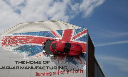 The Jaguar factory in Castle Bromwich, with a Jaguar car mounted on  an external wall surrounded by a Union Jack mural