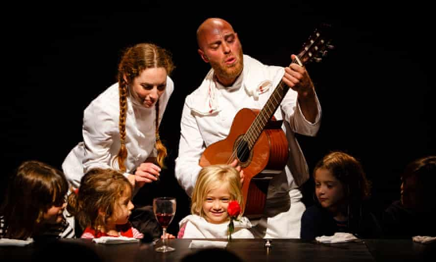 Singing for their supper - children being serenaded at the Table of Delights theatre show.