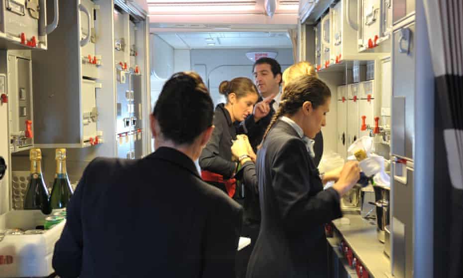 Airline crew members preparing onboard meals.