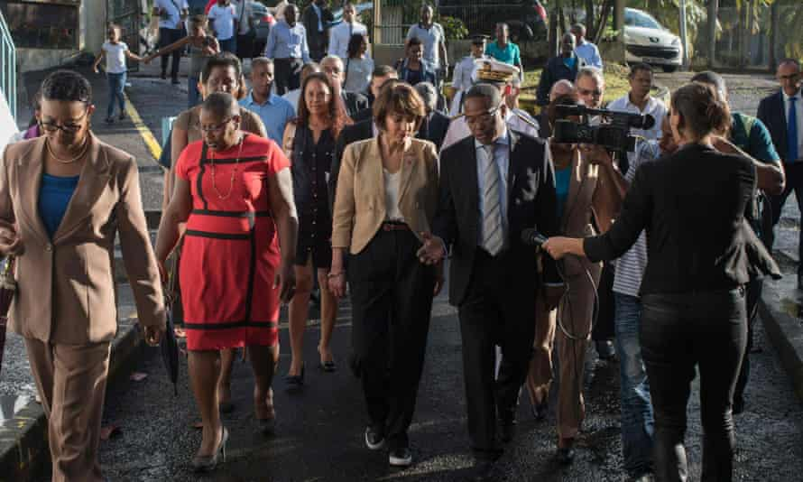 Touraine, centre, talks to local politicians in Fort de France, Guadeloupe, on Friday.