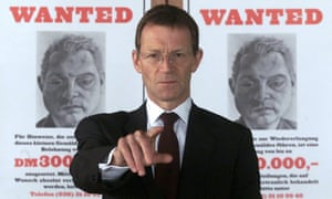 Bring home the Bacon: Tate Director Nicholas Serota in 2001, in front of the Wanted poster designed by Lucian Freud offering a reward for the return of a stolen portrait by Freud of Francis Bacon.