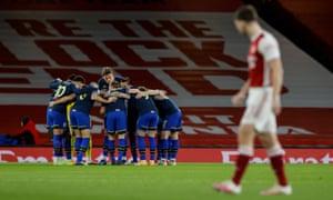 Southampton players huddle before kick off.