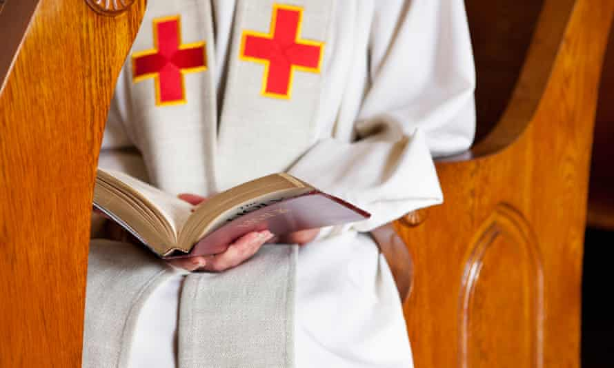 Close up of priest reading the Bible.