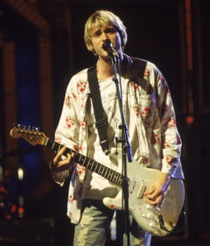 Kurt Cobain performing at the MTV Video Music awards in 1992, wearing his Daniel Johnston T-shirt.