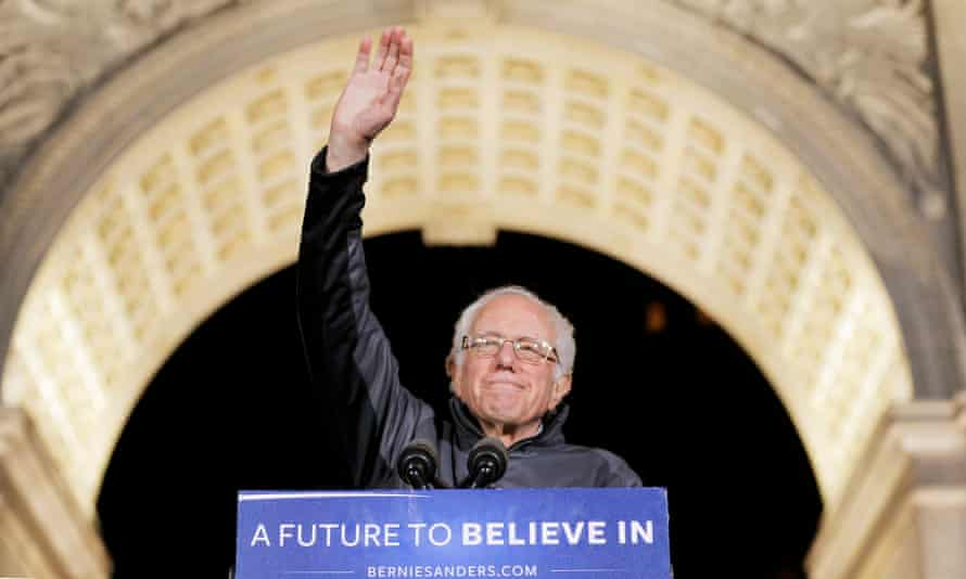 Bernie Sanders salutes the crowd at a campaign rally.