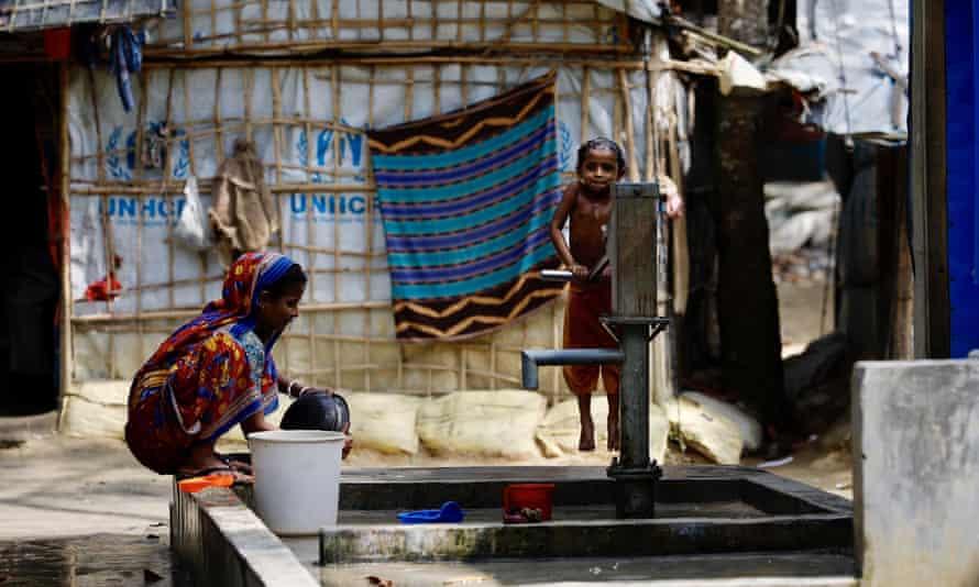 Refugees from Rakhine in Myanmar use a water pump at a refugee camp near Kutupalong, Bangladesh.