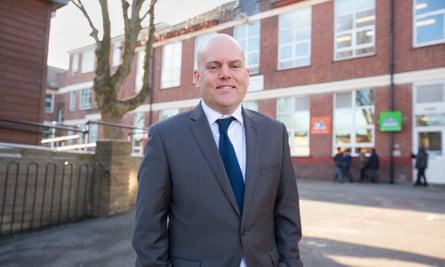 Andrew Moffat in front of school