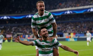 Leigh Griffiths, top, joins Patrick Roberts in celebrating Celtic's second goal against Anderlecht in their Champions League group game.