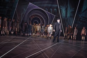 Emil and his gang of child detectives surround the villainous Mr Snow in the National Theatre's 2013 adaptation of Erich Kästner's Emil and the Detectives.