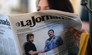 A woman reads Mexico City's La Jornada newspaper, in 2016, which shows a picture of El Chapo shaking hands with Sean Penn.