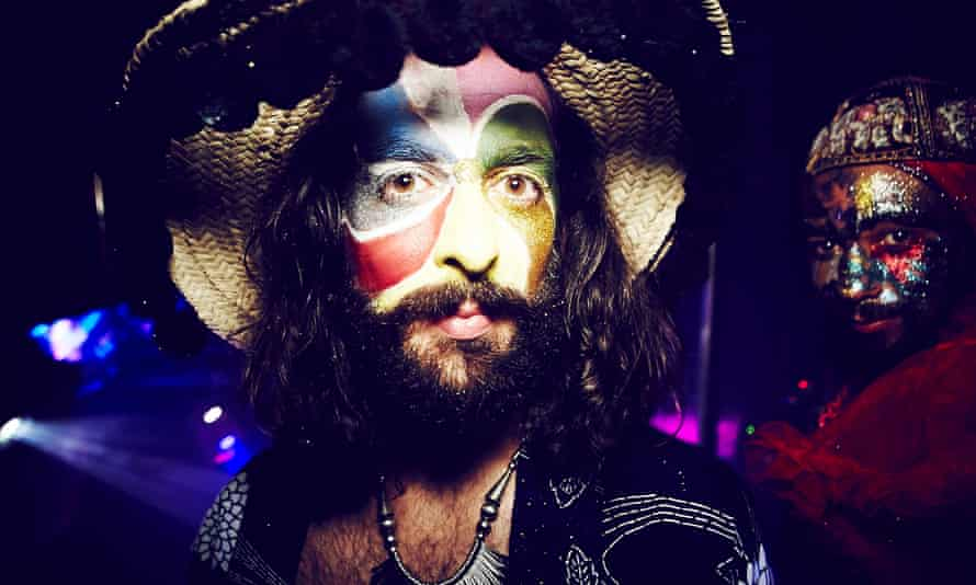 Close up image of a bearded man wearing face paint at the club night Savage. London.