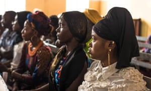 Women look on during a summer hearing on Sierra Leone's ban on pregnant schoolgirls, which was revoked at a court hearing in Nigeria