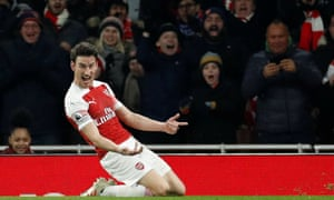 Arsenal's Laurent Koscielny celebrates scoring their second goal.