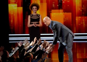 Dwayne Johnson arrives on stage to accept an award