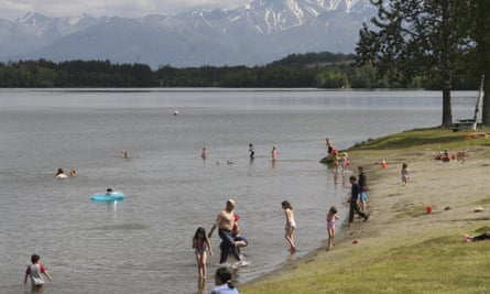 People cooling off in Wasilla Lake in Wasilla, Alaska, last month.