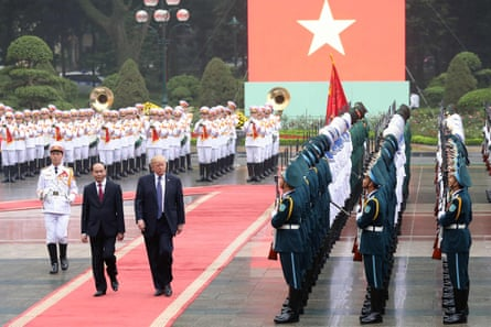 Donald Trump and Vietnamese president Tran Dai Quang at the presidential palace in Hanoi on 12 November.