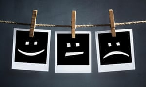 Happy, sad and neutral emoticons on instant print photographs.