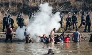 Police officers use tear gas against Water Protectors trying to access Turtle Island on November 2, 2016.