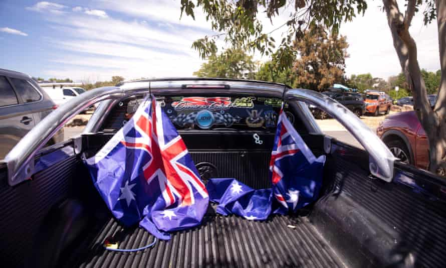 Australian flags are seen tied to the back of a ute on 26 January 2021 in Sydney, Australia