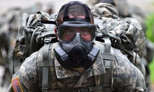 A US soldier wears a gas mask