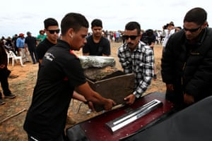 Young men place Mungo Man in Hearse for the last time to be taken to private ceremony at undisclosed location and final resting place.