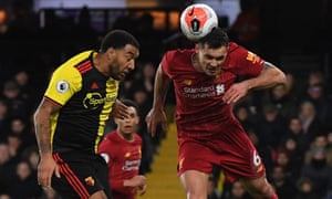 Troy Deeney of Watford (left) goes up for a header with Liverpool's Dejan Lovren.