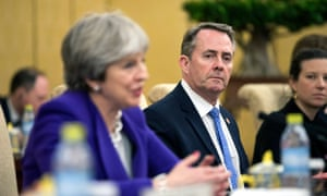 Trade secretary Liam Fox watches as Theresa May speaks during a bilateral meeting with China's President Xi Jinping.