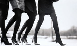 Vogue 1987РFour models, seen from the waist down, walking side by side on a sidewalk; at left, a short dark skirt, by Jean-Paul Gaultier, dark stockings, by Saint Laurent Rive Gauche, and black suede high-heel pumps, by Stephane K̩lian; near left, gray suede skirt, dark stockings, and alligator pumps, all by Saint Laurent Rive Gauche; in center, a dark skirt, by Azzedine Alaia, dark stockings , by Pierre Mantoux, and suede pumps, Alaia by Diego Della Valle; at right, dark skirt with wool covered pumps, by Chanel, and dark stockings, by Hanes CREDIT MUST R