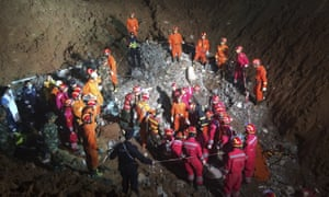 Rescuers surround the area where they found the 19-year-old survivor under a collapsed building.